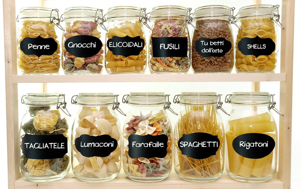 Glass jars filled with various pasta