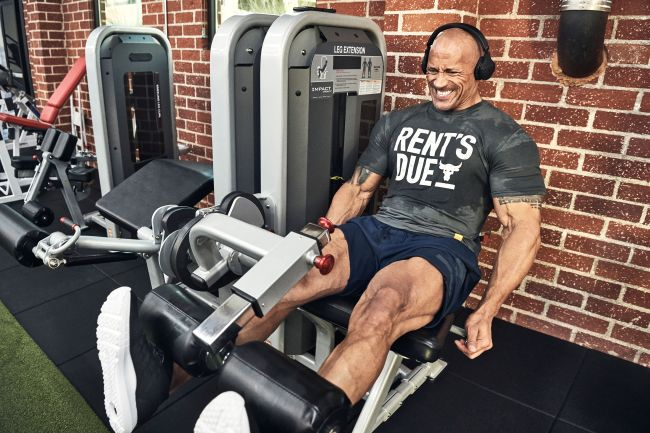 "The Rock wearing the Project Rock ""The Rent's Due"" T-shirt and Project Rock ""Terry Shorts"""