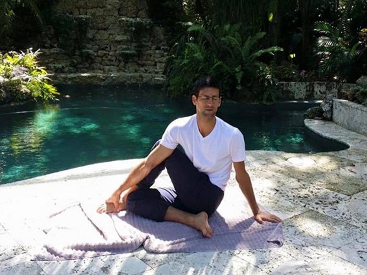 Novak Djokovic doing yoga