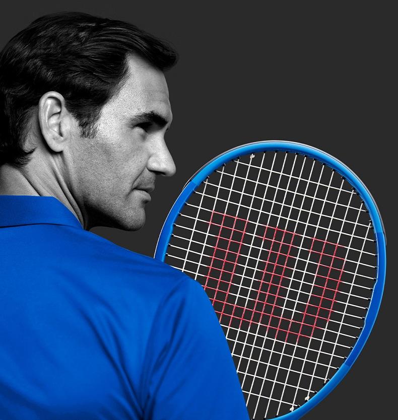Federer holding a racket