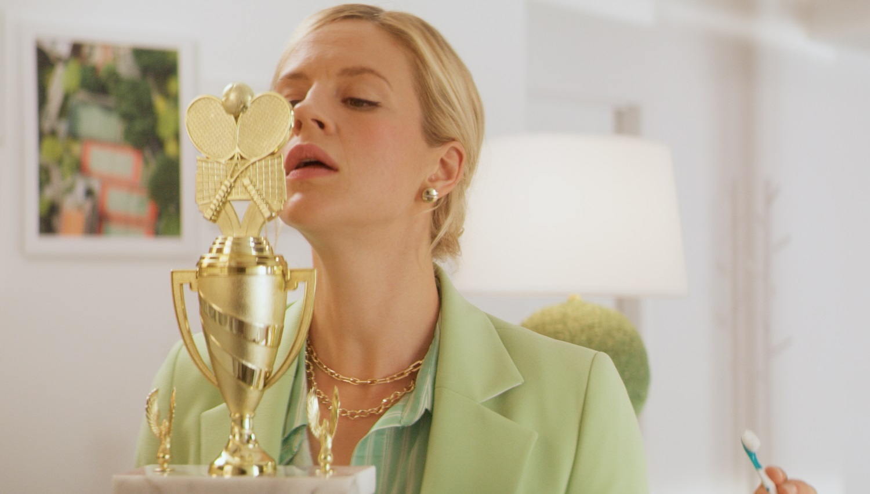 Bobbi polishing her trophy